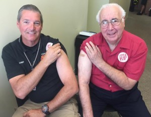 Estero Fire Chief Scott Vanderbrook (left) and Mayor Nick Batos remind residents it's time for your flu shot.